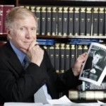 Michael Kirby admiring a picture of himself