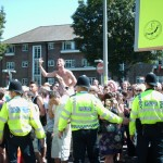 Police protecting Christians from homosexuals during a 'gay pride' march in Brighton in southern England.