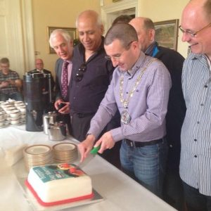 Cllr Andrew Muir campaigns for 'gay marriage' by cutting the 'QueerSpace' cake.