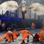 The dancers in orange jump-suits represent the five workers who died  building the Gotthard Base Tunnel.  As for the woman dressed as a bird?