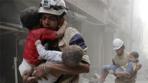 White Helmets as they like to be seen, rescuing babies.