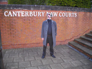 The defendant before a similar case in January. Face obscured