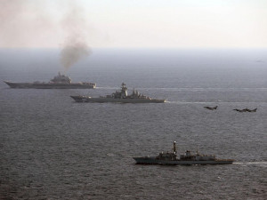 Admiral Kuznetsov (background) and Petr Velikiy shadowed by HMS St Albans (foreground) steaming through the English Channel on their way back to Russia.  Sir Michael Fallon described the aircraft carrier as a 'ship of shame', 'skulking' through the Channel.