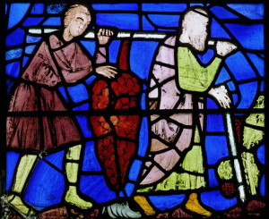 The spies return - with improbably large clusters of grapes in this stained glass window.