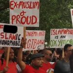 Homosexuals and a few ex-Muslims carry banners insulting Islam in the London Gay Pride Parade