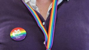 National Trust goes gay with 6-colour homosexual rainbow badges and lanyards - but volunteers objected.