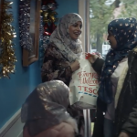 Muslim women clutch a Tesco shopping bag. But Tesco don't have a halal turkey for them.