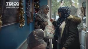 Muslim women clutch a Tesco shopping bag. But Tesco don't have a halal turkey for them.