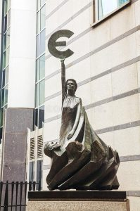 This scary sculpture of a woman holding the Euro aloft while men grovel at her feet is outside the EU Parliament building in Brussels.