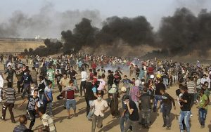 Riots in Gaza near the border with Israel. The smoke from burning tyres is intended to obscure the participants from recognition and sniper fire.