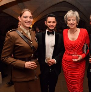 How the nations go mad. UK Prime Minister Theresa May with transgender 'power couple' 'Hannah' and 'Jake' (see below).