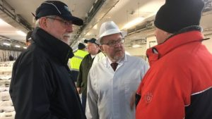 Rt Hon David Mundell,(in the white cost) assures fishmongers in Peterhead the Brexit vote is going ahead.