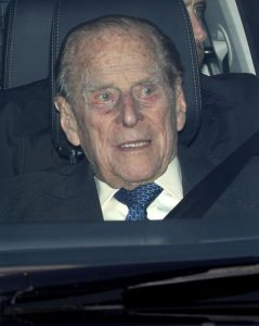 Prince Philip, HRH Duke of Edinburgh, in the front seat of his Land Rover Discovery.